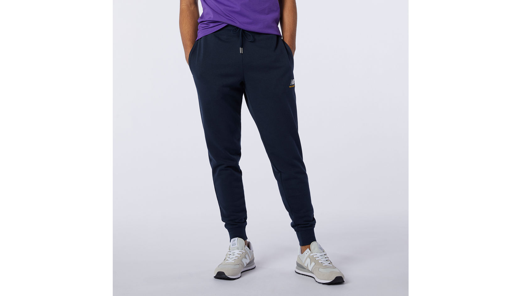 Брюки Essentials Embroidered Pant New Balance MP11590/ECL